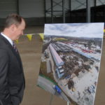 Timothy P. Murray,  Chamber president, looks at a picture of the old U.S. Steel building.