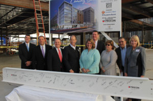 Celebrating steel construction of the new AC Marriott Hotel, from left to right, Donald Birch, executive VP/COO at Leggat McCall, Tony Economou, Worcester city councilor District One, Tim Murray, president and CEO of the Worcester Regional Chamber of Commerce, Mark Stebbins, chairman and CEO at PROCON and Partner XSS Hotels, Ann Tripp of Opus Investments, City Manager Edward Augustus, Jr., Candy Mero-Carlson, District Two city councilor, Leo Xarras, partner at XSS hotels, Christine Thomas, development partner at XSS Hotels.