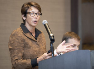 Dr. Lisa Olson of AbbVie Bioresearch Center in Worcester addresses more than 300 business professionals at the Worcester Regional Chamber of Commerce's Breakfast Club at the AC Marriott Hotel on September 5.