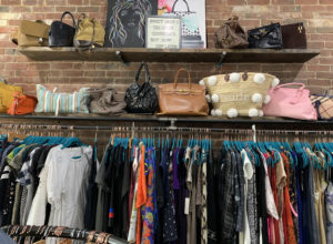 Two of the city's retail-oriented neighborhoods, Main Street and the Canal District, are undergoing ongoing construction projects deterring foot traffic and possible consumers. The solution may be as simple as a hashtag - #ShopWoo. Pictured is a display at Sweet Jane's Designer Consignment on Main Street. / PHOTO BY EMILY GOWDEY-BACKUS