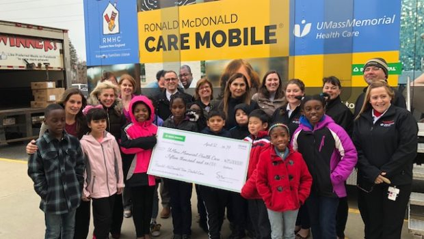Delta Dental presents a check to UMass Memorial toward the operation of the UMass Memorial Ronald McDonald Care Mobile. Just one example of the health care system's community-wide presence, the Care Mobile provides medical and preventive dental services in 10 low-income neighborhoods and at 20 inner-city elementary schools in Worcester, regardless of a patient's insurance status. Care Mobile staff also provide connection to social support services. / PHOTO COURTESY UMASS MEMORIAL