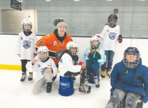 Railers staff and team members interact with WPS students during a recent Skate to Success session. / PHOTOS COURTESY WORCESTER RAILERS.